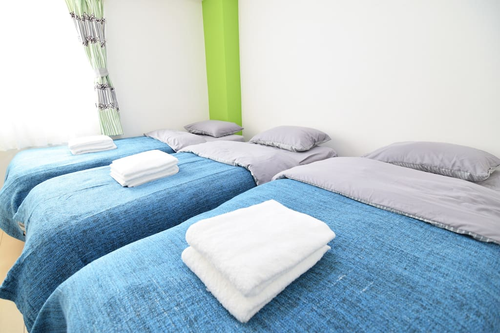 Bed Room 2 with 3 single beds.