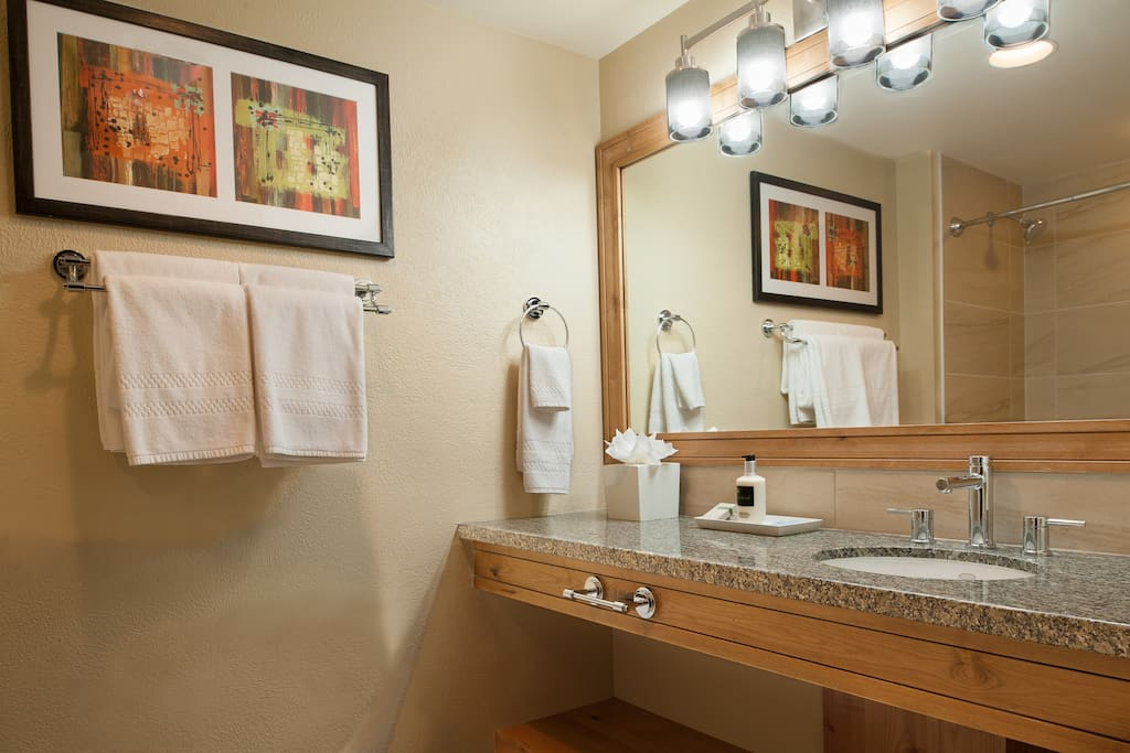 Prepare for the day ahead in the bright and modern bathroom.