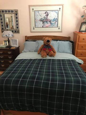 Large guest room with queen sized bed with private access to bathroom..,