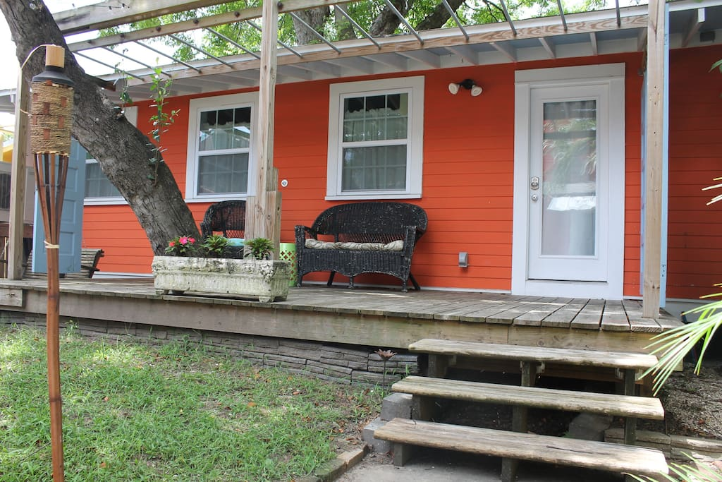 Enjoy your morning coffee or your happy hour cocktail on a lovely covered porch