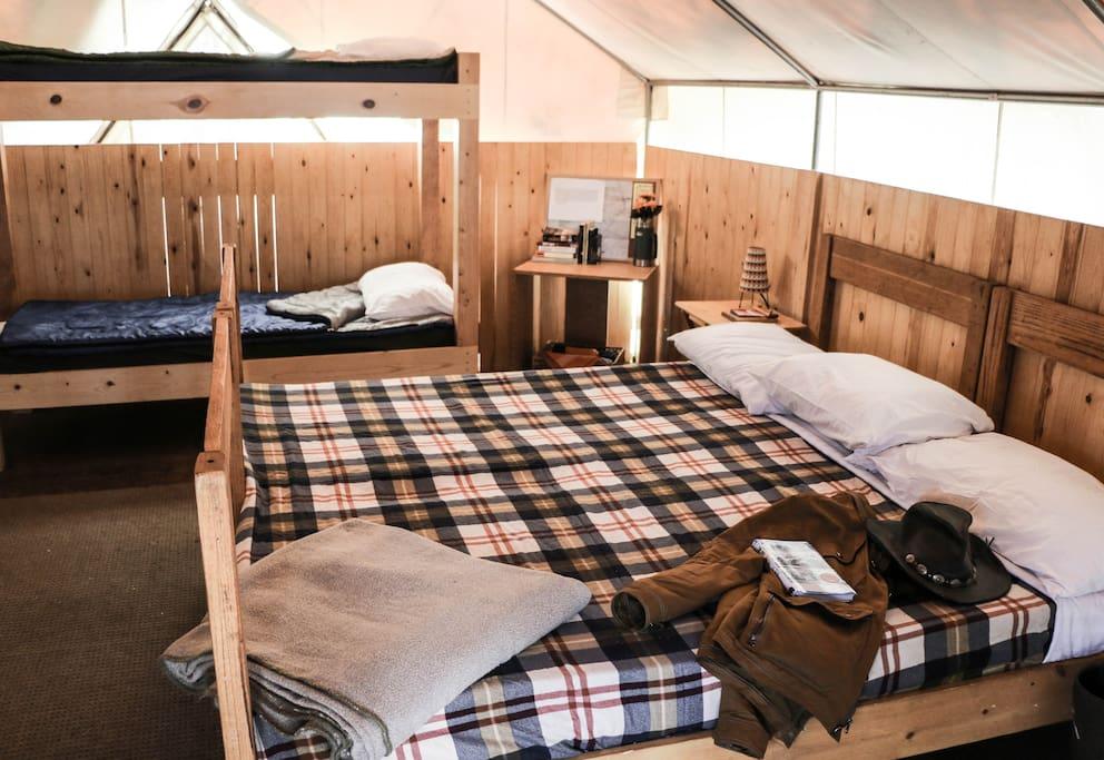 Queen bed and bunk beds.
