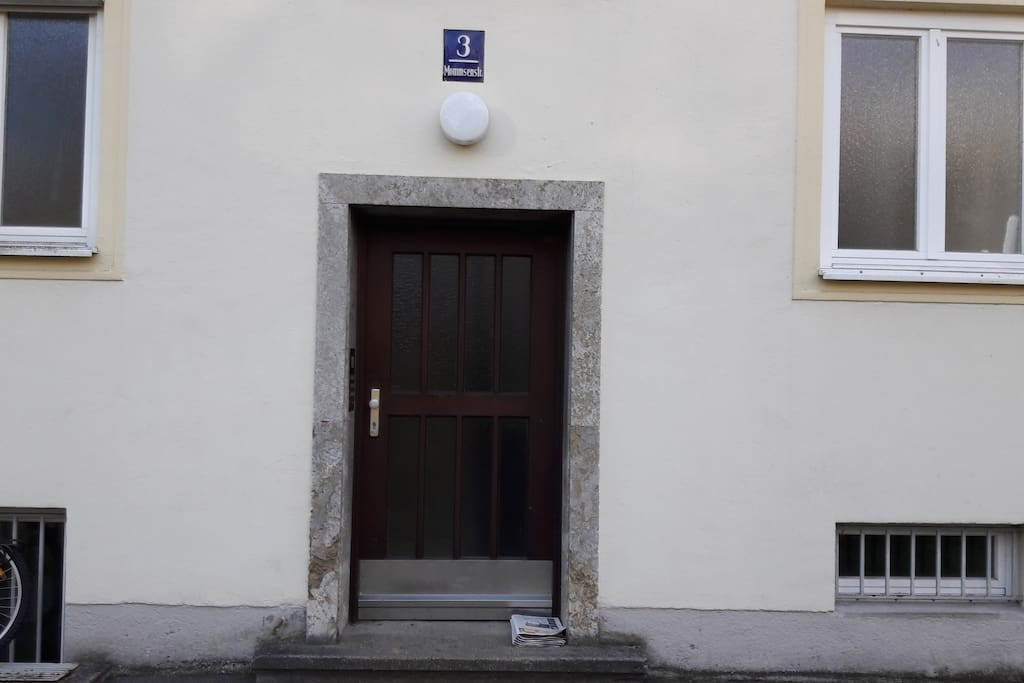 The building door. The actual apartment on the ground floor on the left side