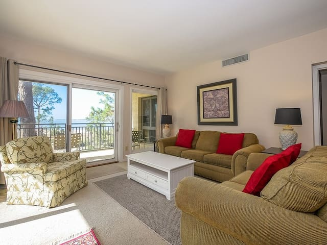 Living Room with Balcony Access at 1873 Beachside Tennis