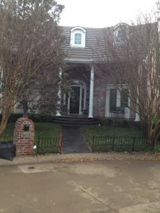 Front Entry - a New Orleans style curb appeal with comfortable seating on the front porch