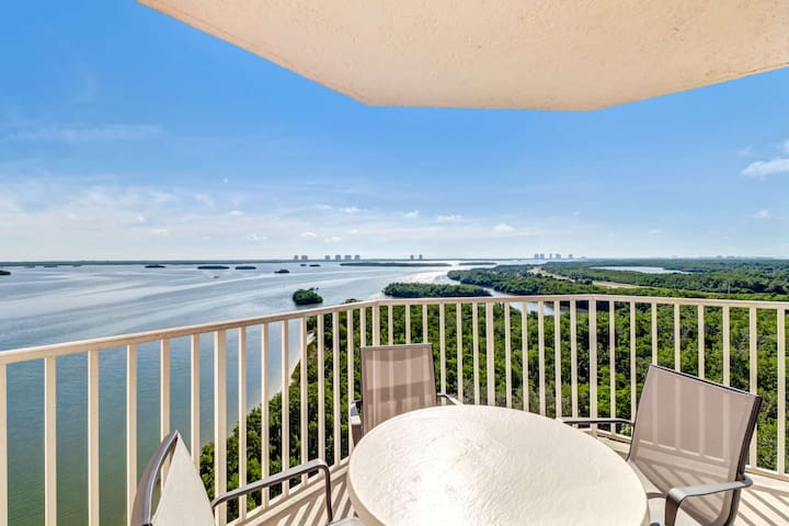 Outdoor dining for four with a view of the Estero Bay as far as the eye can see, with Bonita Springs and Naples in the distance.