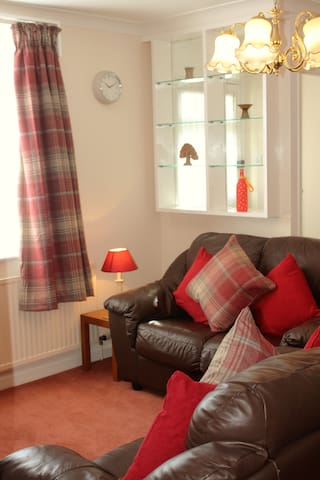 Comfy sitting room with Smart TV and DVD player