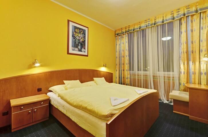 Čtyřlůžkový pokoj v hotelu Slunce