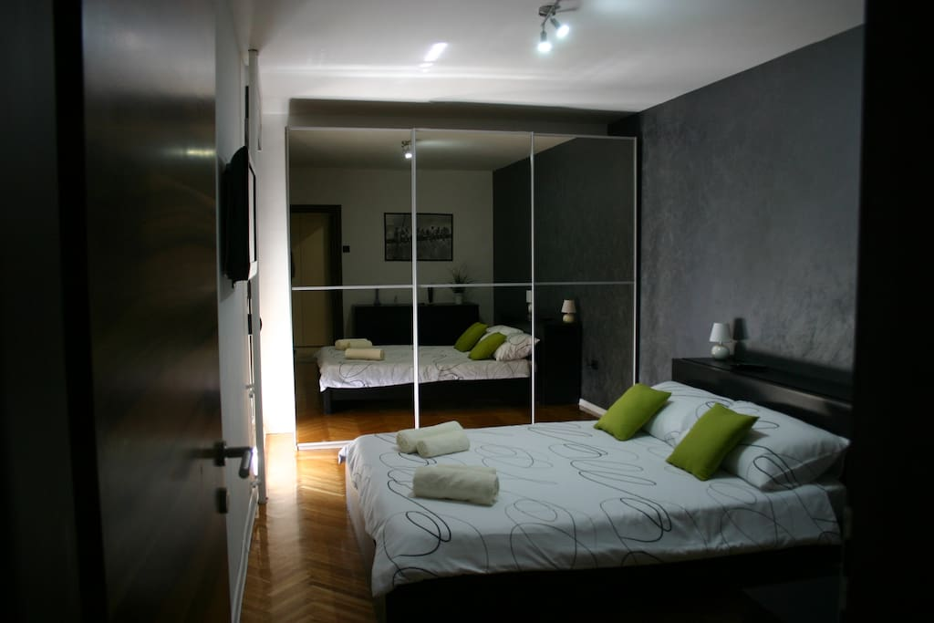 Master bedroom with big closet, tv and balcony with sea view