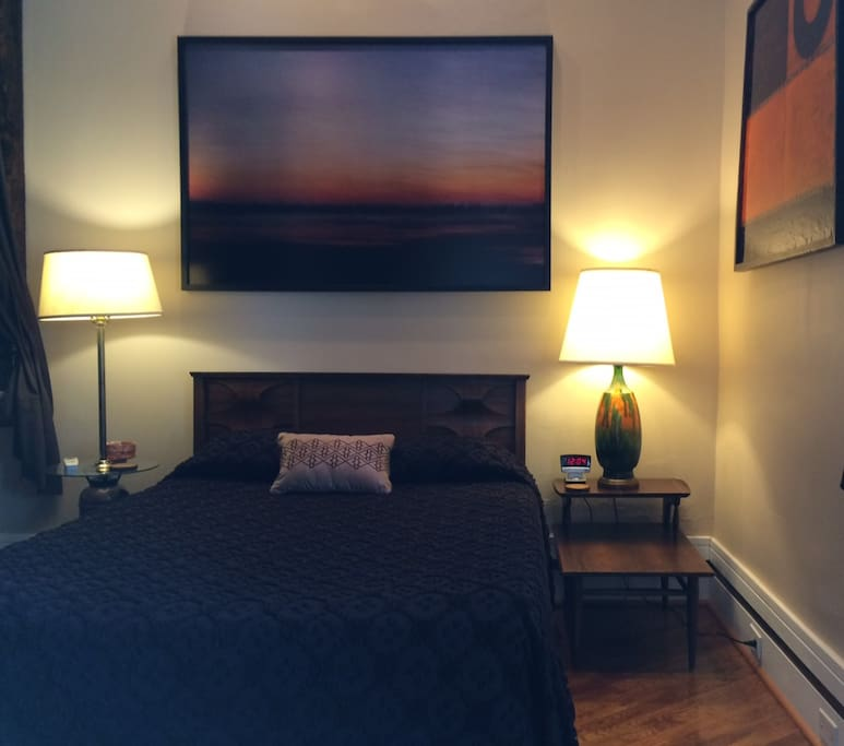 Full size tempurpedic bed on main floor of studio