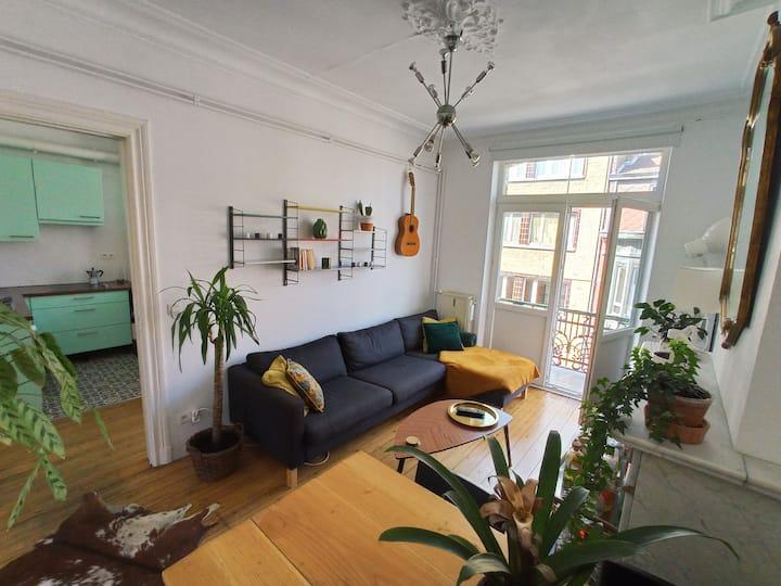 Appartement cosy, terrasse et vue sur les toits