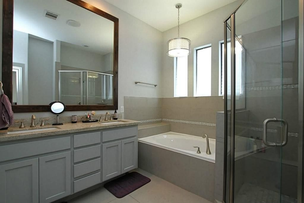 Chic bathroom with plenty of space. Oversized bathtub and large shower. Private toilet.