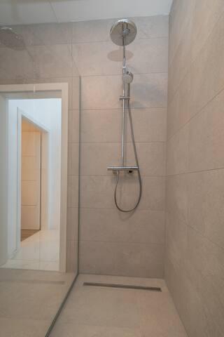 Luxury furnished bathroom on 1st floor with walk in rain shower