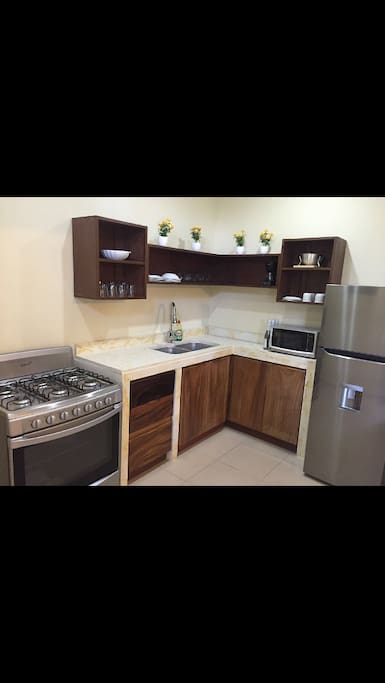 Fully equipped kitchen, double sink, custom counter top and kitchen