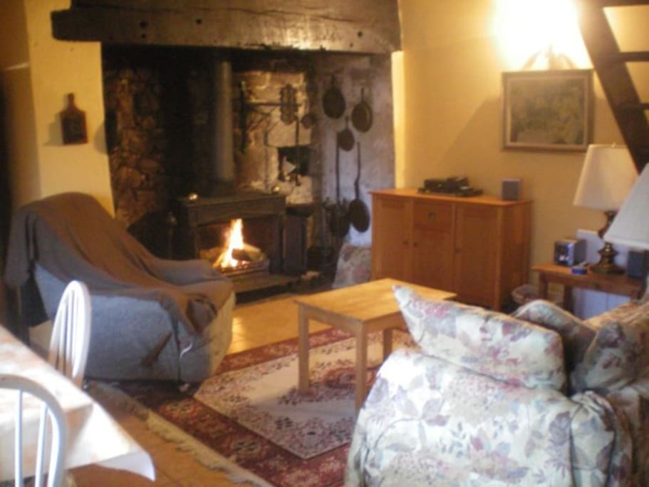 Beautiful inglenook fireplace with open woodburning stove.