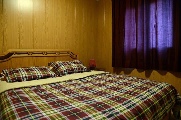 Double bed bedroom.