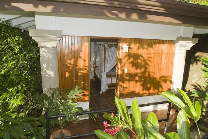The private separate casita with queen bed just steps from the main house
