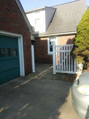 Access to the entrance for the apartment is at the back of the house through this gate.
