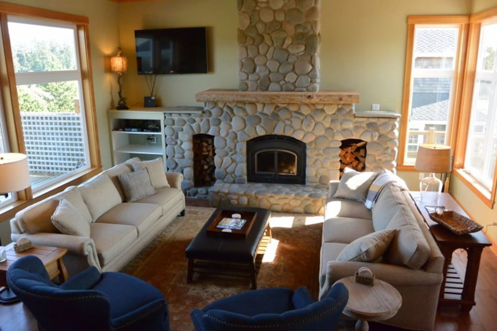 Amazing living room with large stone wood burning fireplace. Plenty of seating and feature a flat screen TV.