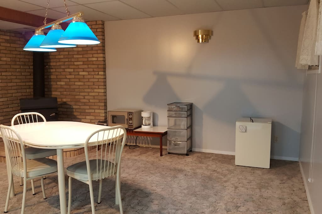 A common area with a microwave, coffee maker, and mini fridge.