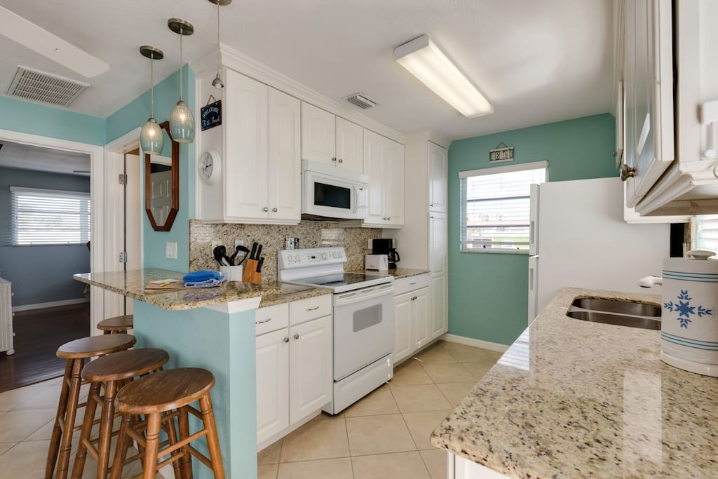 Full kitchen with all appliances and dishware