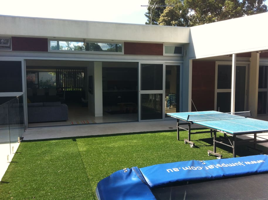 Rear looking into open Kitchen & Family (trampoline + table tennis)