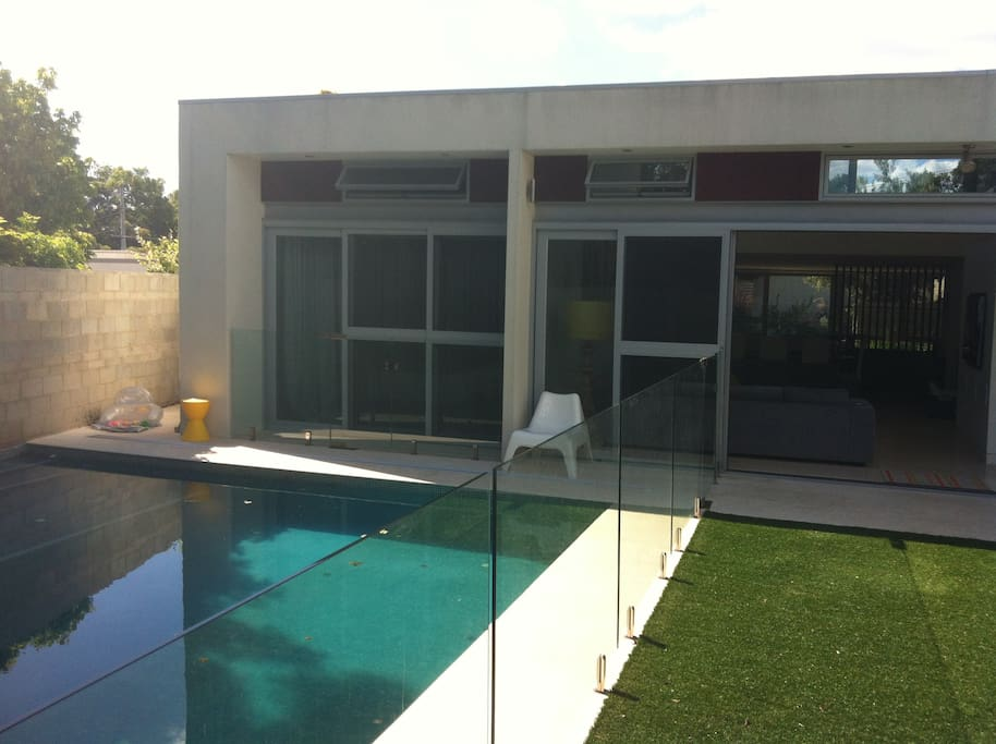 Rear looking into pool and Master Bedroom