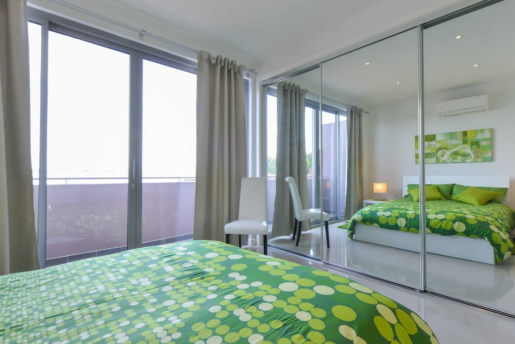 Huge bedroom suite with private balcony.