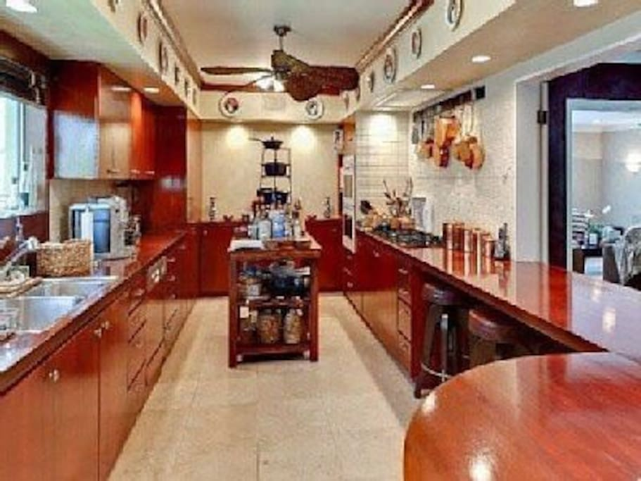 Kitchen with chef cutting board, does not have as many pots and pans now so please bring your one cooking pots .