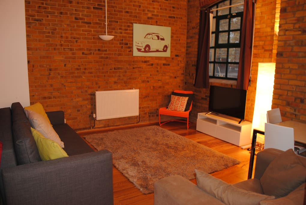 Old warehouse conversion with 3 seater sofa bed