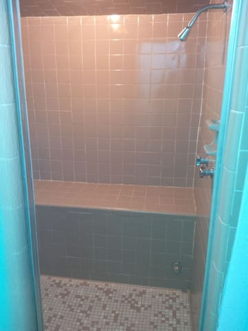 Large double shower with two heads and bench. Great water pressure!