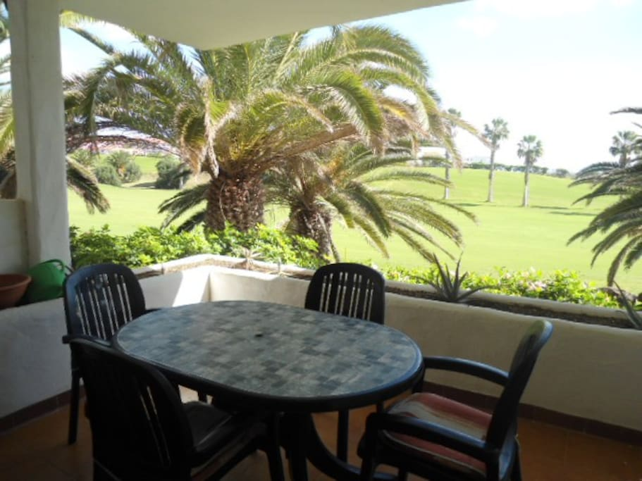Terrace with views over the golf course and the sea