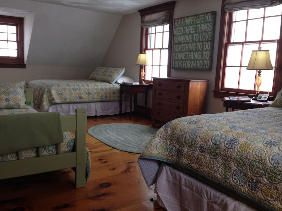 Secretariat Room: 2 queens, 1 twin bed with private bathroom (standing shower)