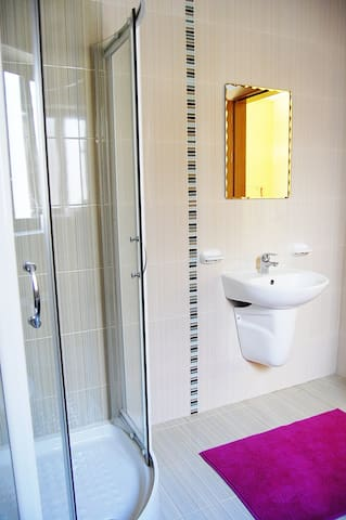The spacious bathroom with the mirror to see how beautiful you are!