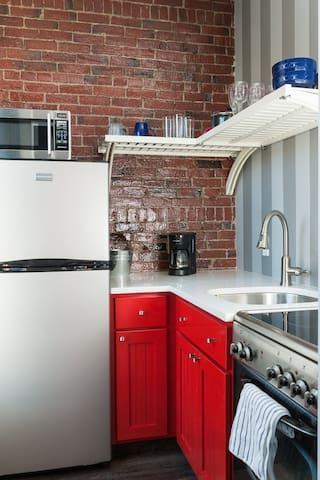 Modern kitchen: brick, stainless and granite
