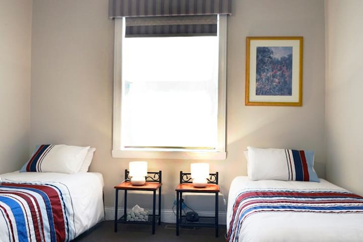 The second bedroom has two king single beds