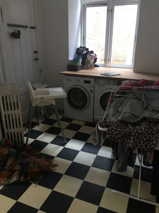 Laundry room in the flat with washing maskine and dryer