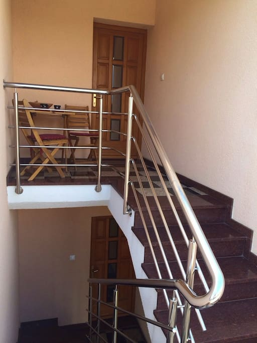Apartment B is on the top floor!  The entrance to both apartments is separate... so you can lead a private life.  Small table facing a country road, gardens, and the mountain ranges of Croatia (velebit is near.. and so is lake vrana)...