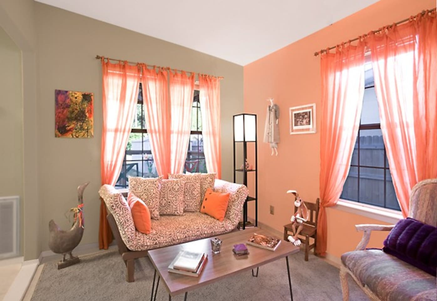 Original art and bright colors decorate the Living Room