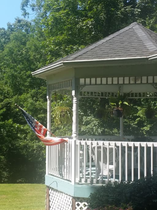 Enjoy a relaxing time on the gazebo on the front porch.