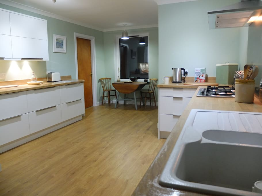The kitchen is large and spacious with a view into the forest