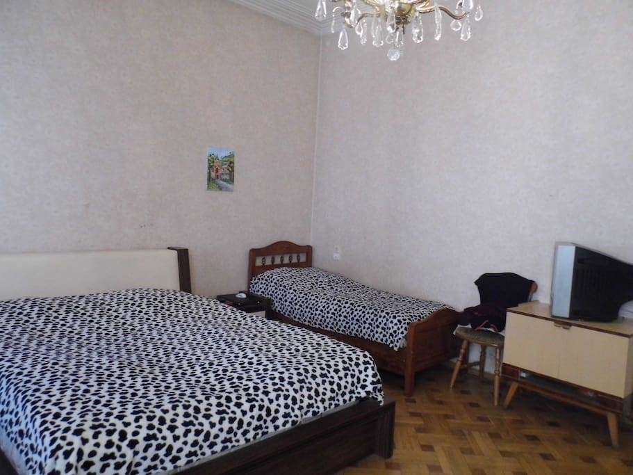 the bedroom with one double bed and one single bed.