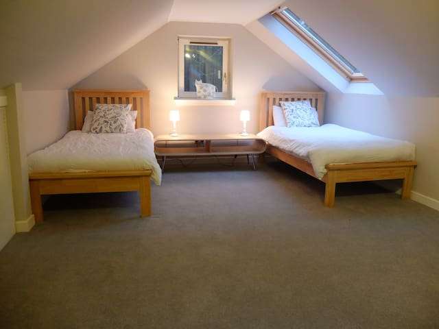 The large upstairs bedroom, can be made into a triple.