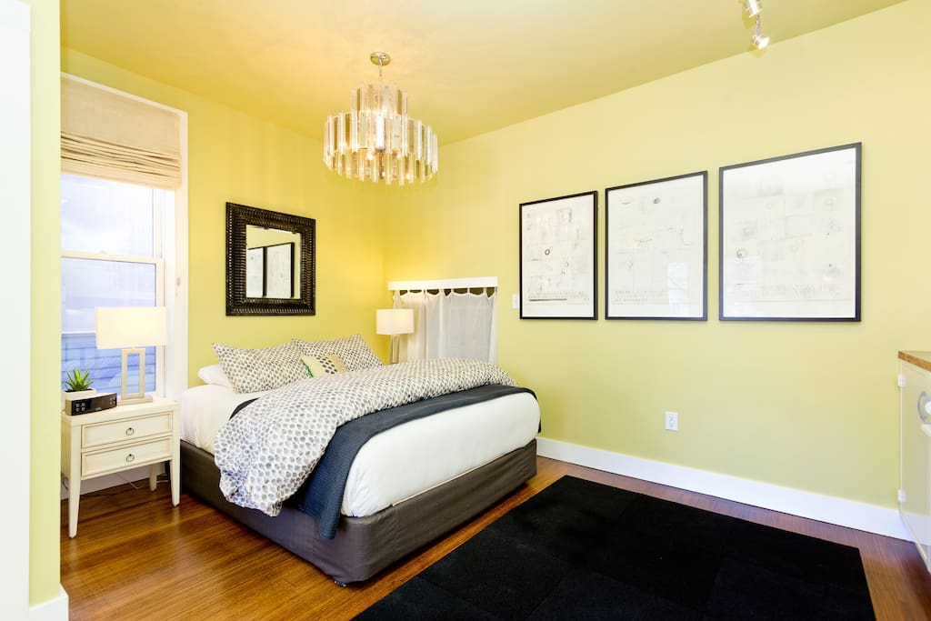The Story Suite has 10 ft ceilings, beautiful hardwood floors and access to the front porch with bistro table and chairs. Each suite has original artwork by local artists. The curtains are the closet; working with an 1895 historic building, we have had to