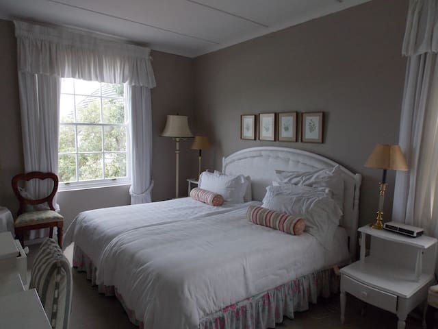 Light and bright upstairs , two bedded ensuite bedroom