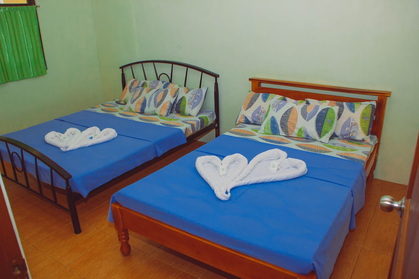Enclosed air-conditioned bedroom w/ 2 queen size beds