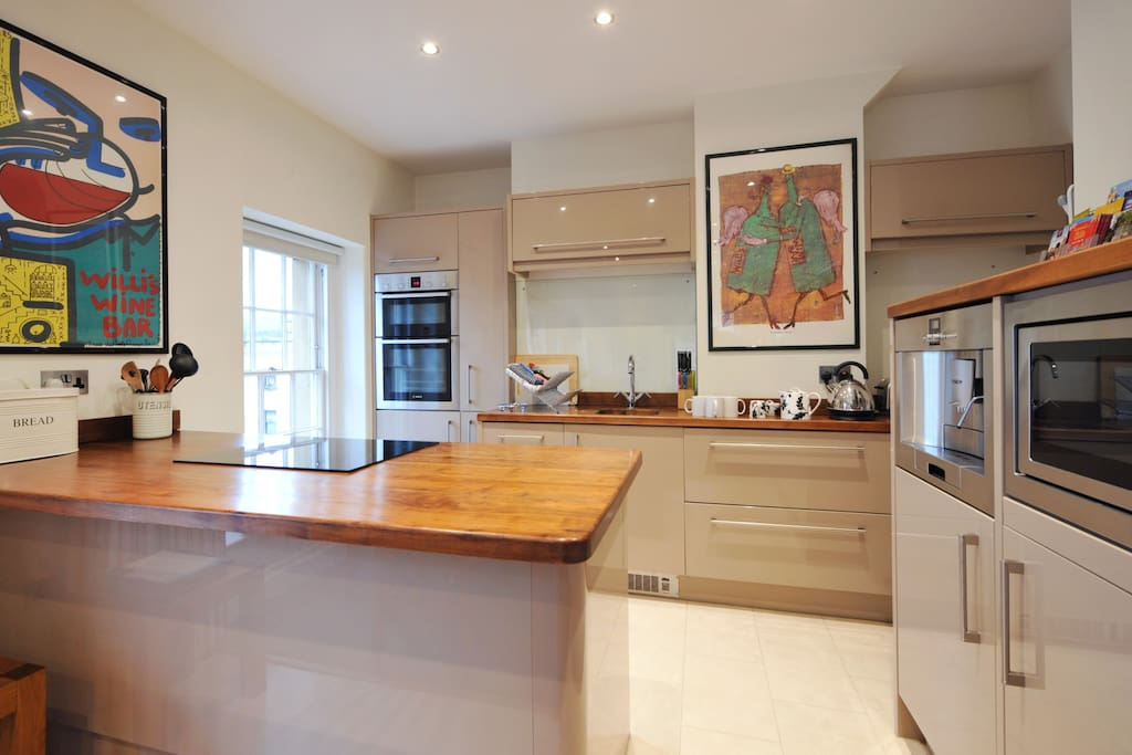 Both kitchens are designed by BOSCH and have all appliances required including a built in coffee machine seen here right