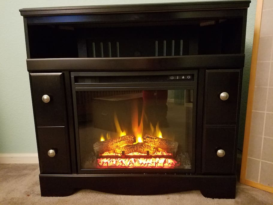 Electric fireplace with remote, timer and 3 heat settings.