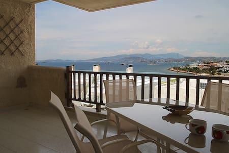55m modern apartment + garden, unlimited sea view. - Saronida