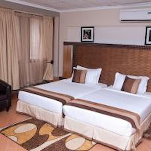 Our Studio twin bed is  fully air conditioned and comfortable room. It features a bathroom, a queen sized bed, fitted   minibar, wardrobe, desk,coffee/tea maker,colour television,free high speed wifi,hairdryer ,iron and ironing board,sitting area.