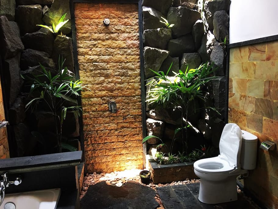 A gorgoeus bathroom. Local stone and plants with modern sanitary ware. Delightful!